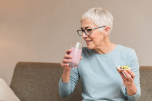 older woman drinking milkshake