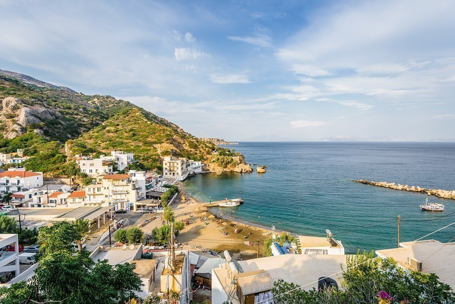 Beautiful sunny summer coast view to the greek blue sea with crystal clear water relaxing holiday beach perfect for sunbath at the shore or eating restaurant dinner, Therma, Ikaria, Sporades, Greece