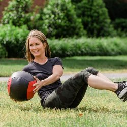 woman working out with fitness ball