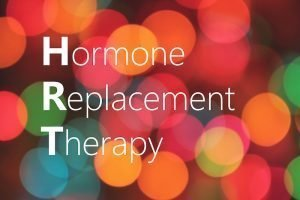 HRT (Hormone Replacement Therapy) acronym on colorful bokeh background